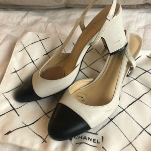 Black and white cap toe sling backs